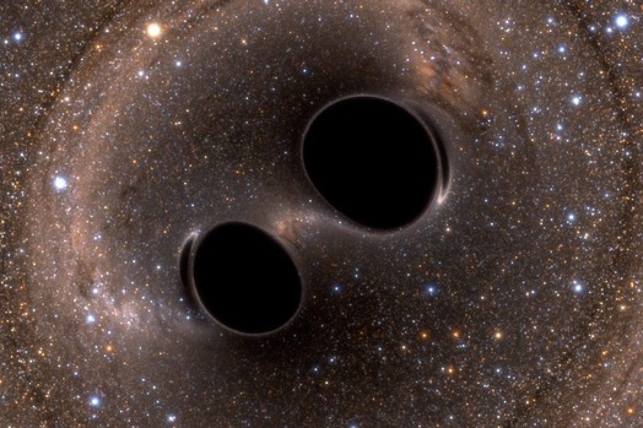 Gravitational waves being released. (Simulating eXtreme Spacetimes/ Wiki Commons)