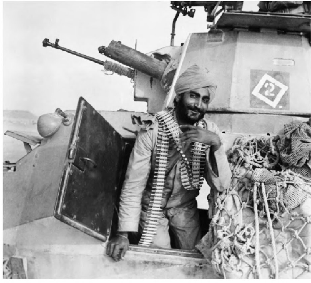 An Indian soldier of the Fourth Indian Division in a armoured vehicle with a bandolier around his neck in Egypt, 1941.