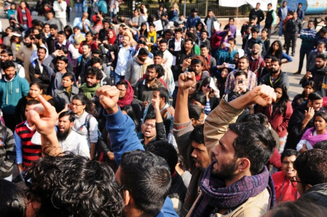 Students in Jawaharlal Nehru University protesting (Burhaan Kinu/Hindustan Times via Getty Images)