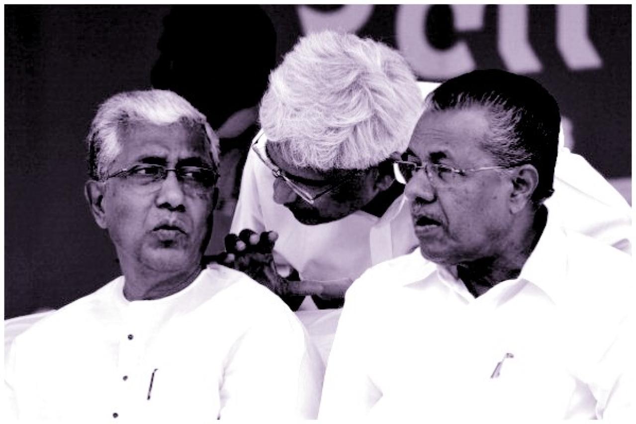 Former CPI-M general secretary Prakash Karat (C) speaks to the chief minister of Tripura, Manik Sarkar, as Kerala Chief Minister Pinarayi Vijayan looks on. (Arijit Sen/Hindustan Times via Getty Images)