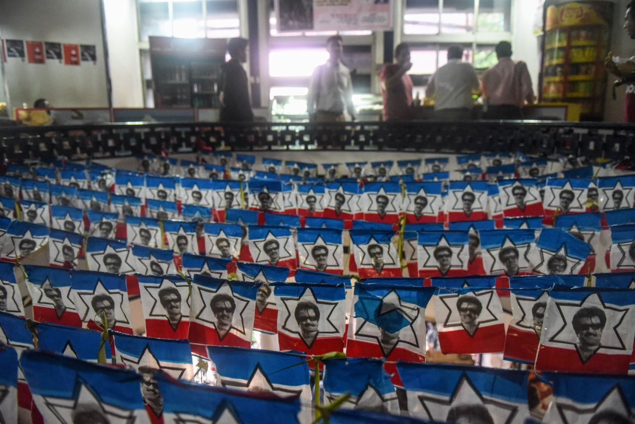 A cinema hall decorated with the flags bearing images of Rajinikanth in Mumbai. (Pratik Chorge/Hindustan Times via GettyImages)