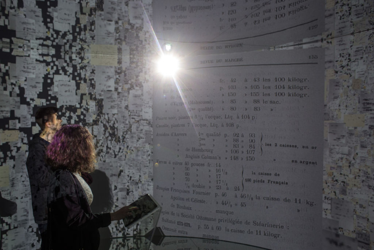 People view historical documents and photographs displayed in a high tech art installation at Salt Galata on May 6, 2017 in Istanbul, Turkey. The 'Archive Dreaming' installation by artist Refik Anadol uses artificial intelligence to visualize nearly 2 million historical Ottoman documents and photographs from the SALT Research Archive. (Chris McGrath/Getty Images)