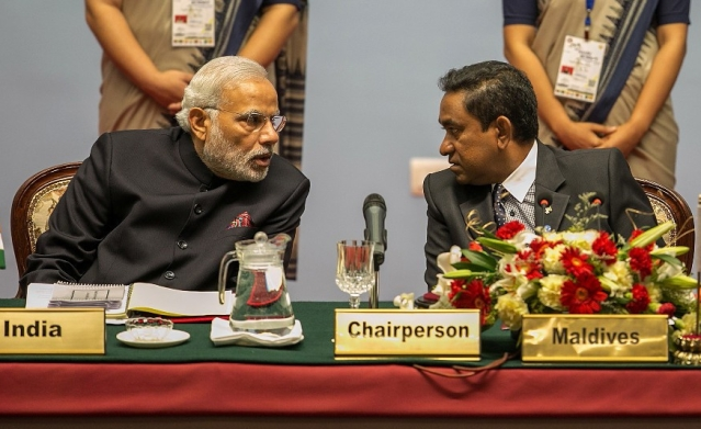 Prime Minister Narendra Modi speaks to Abdulla Yameen, President of the Maldives during  the 18th SAARC Summit in  Nepal. (Narendra Shrestha - Pool/Getty Images)