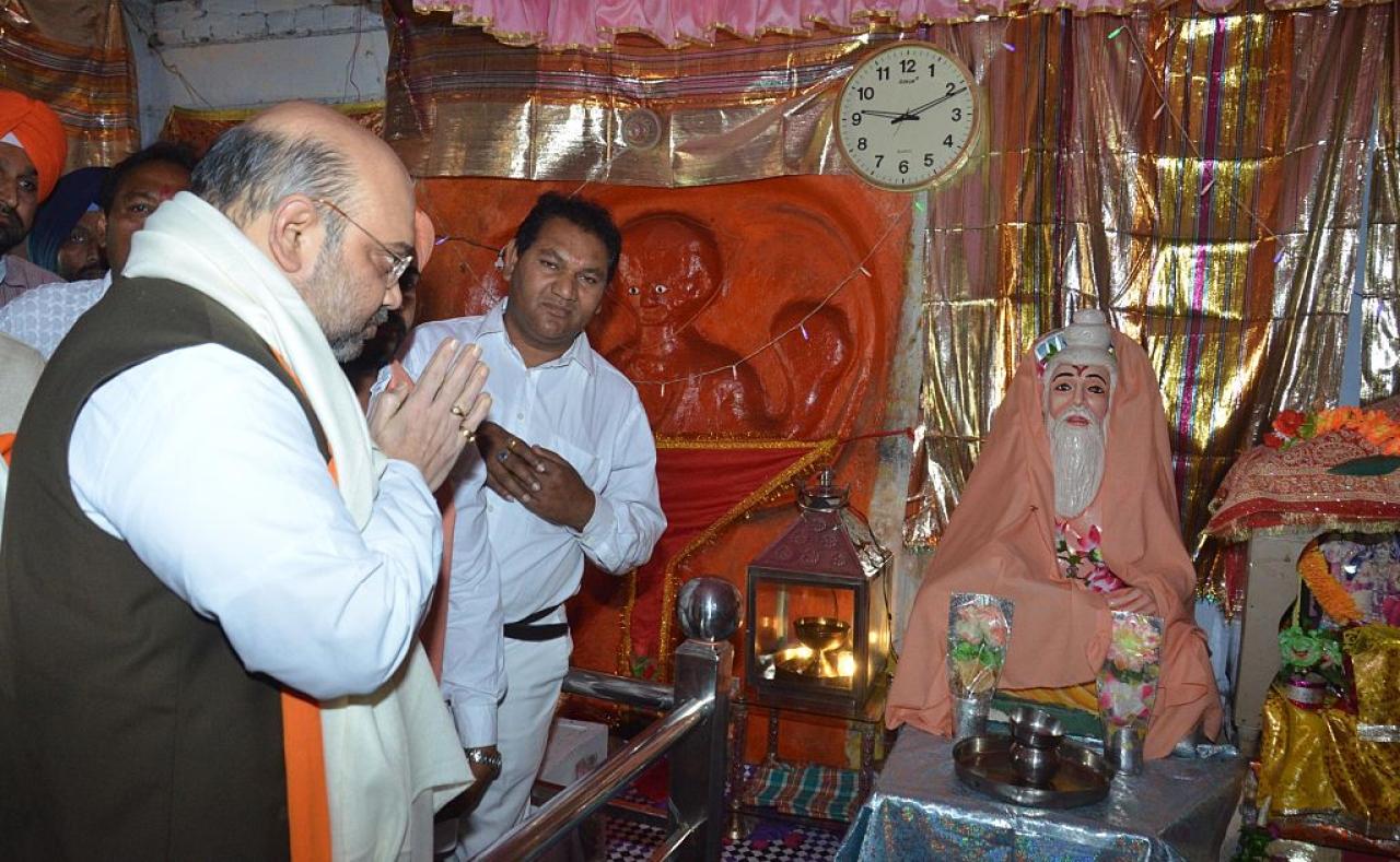 Bharatiya Janata Party president Amit Shah paying his respects at the historical Ram Tirath Temple on May 3, 2015 in Amritsar, India. (Sameer Sehgal/Hindustan Times via Getty Images)