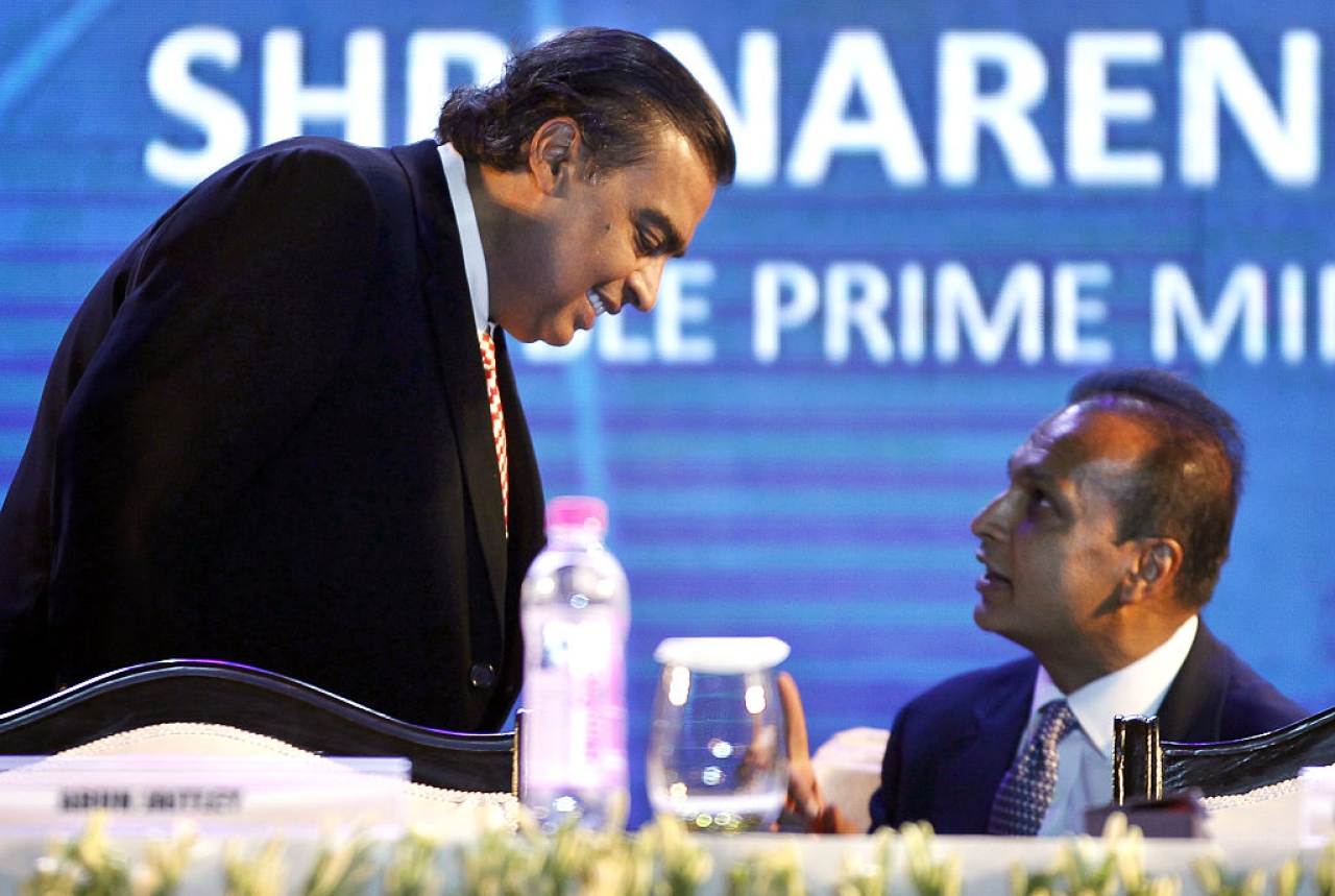 Mukesh Ambani and Anil Ambani during the launch of Digital India Week by Prime Minister Narendra Modi in New Delhi. (Ajay Aggarwal/Hindustan Times via GettyImages)