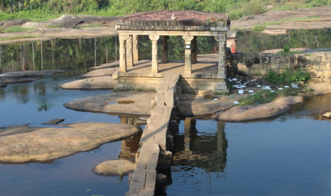 A stone <i>Mandapam</i> attached to the <i>Thirparapu Mahadeva</i> temple – one of the twelve temples. Note the scenic beauty being marred by the wastes dumped near the Mandapam.