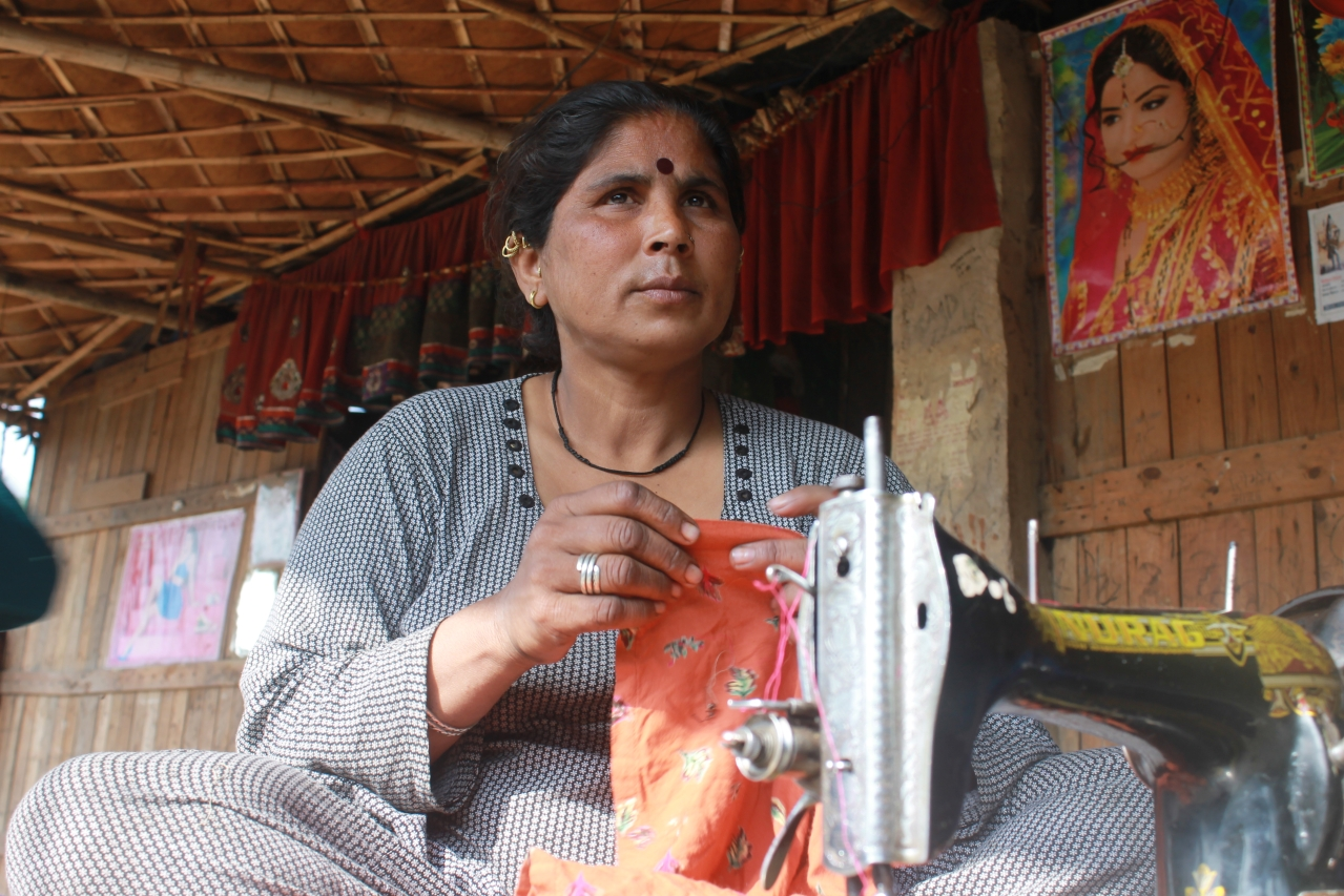 Ganga gets her sewing machine out in the sun