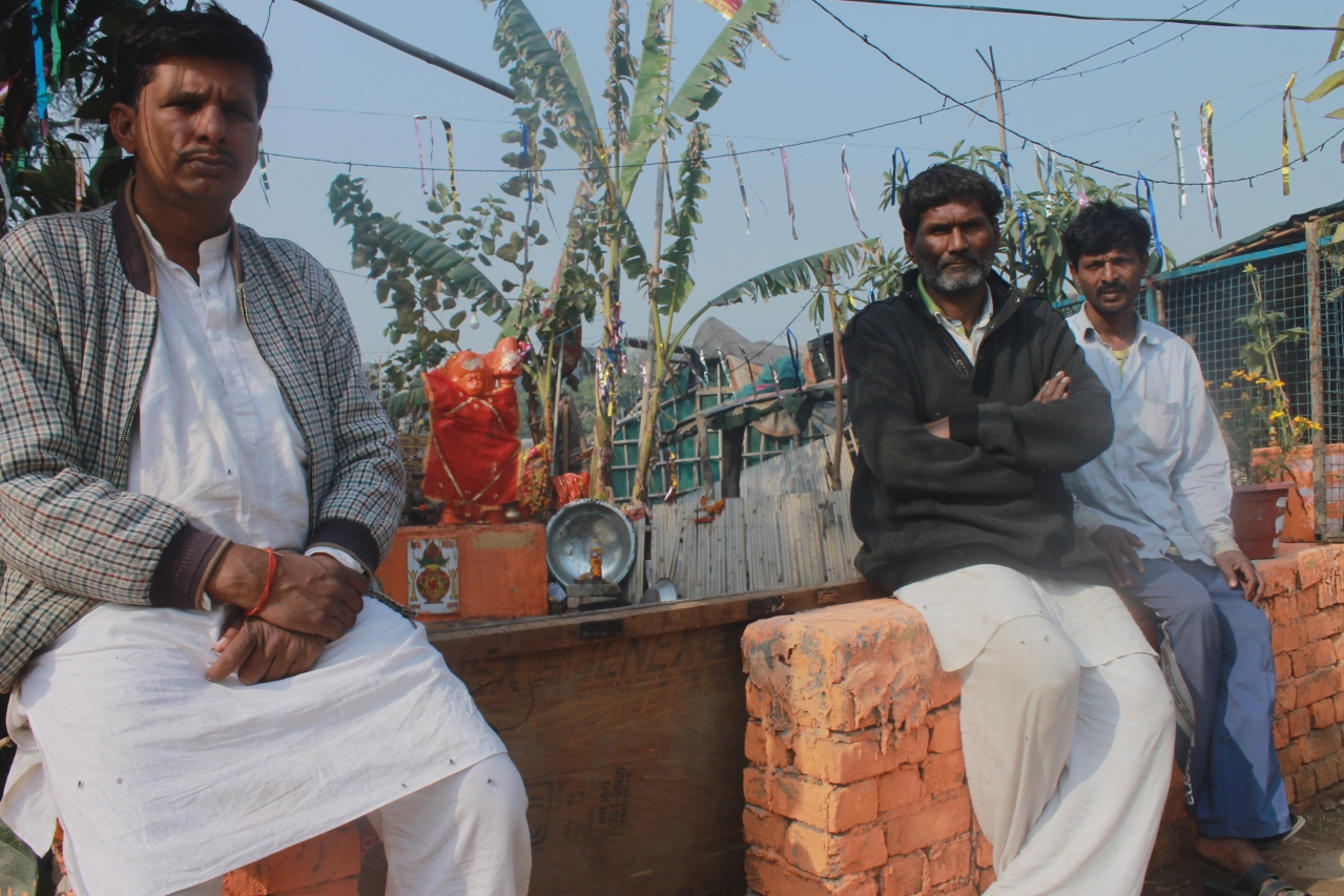 Hanuman Prasad, left, at the make shift temple at a Rohini camp.