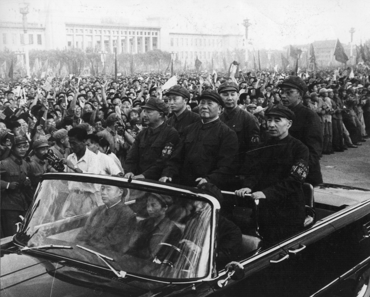 Chinese leader Mao Tse-tung (1893-1976), accompanied by his second-in-command Lin Biao (1907-1971), passes along the ranks of revolutionaries during a rally in Tiananmen Square, Peking (Beijing), 1966. (Keystone/Getty Images)