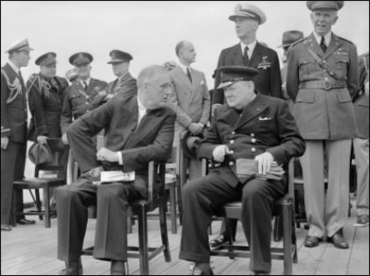 Franklin D Roosevelt and Winston Churchill seated on the quarterdeck of HMS Prince of Wales following a Sunday service during the Atlantic Conference, 10 August 1941. (Wikimedia Commons)