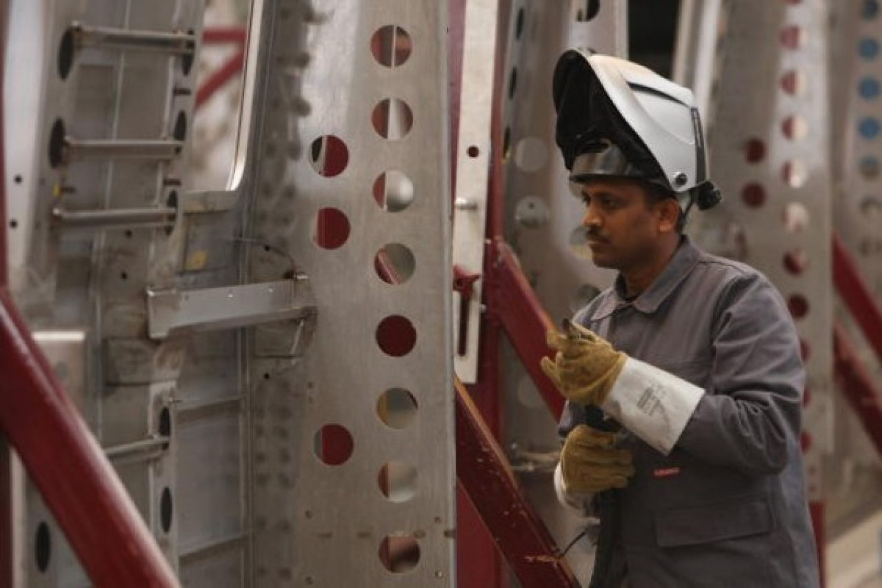 A worker  welds the fuselage of a subway car destined for New Delhi (Sean Gallup/Getty Images)