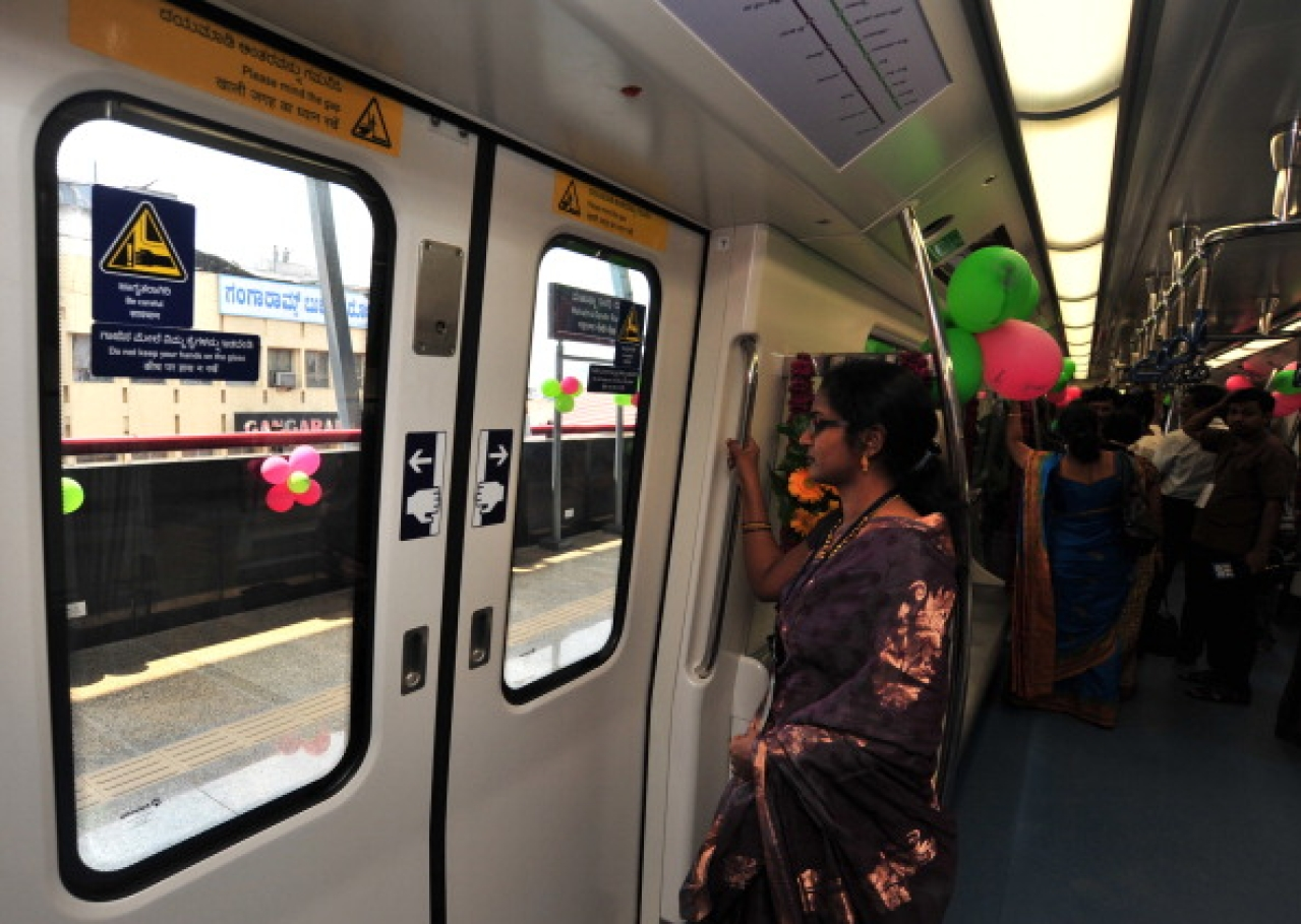 A commuter stands by the door on the Namma Metro in Bengaluru. (Jagdeesh MV/Hindustan Times via Getty Images)