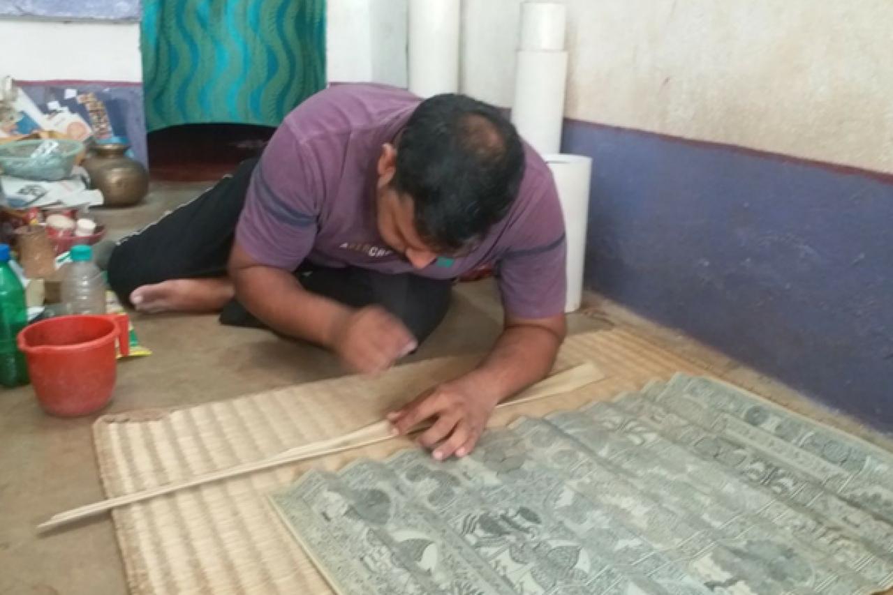 Sridhar Nayak works on a Pattachitra