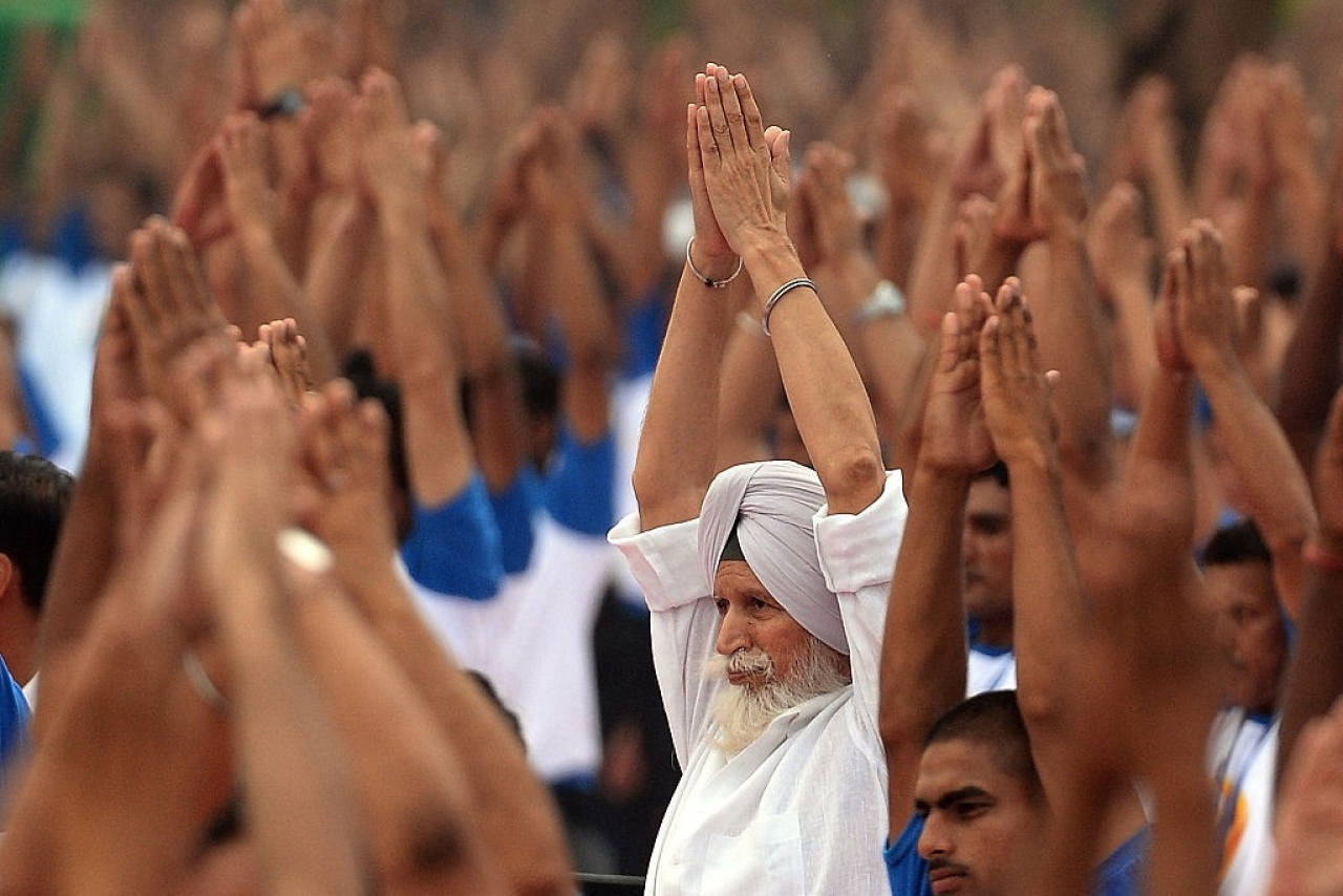 Yoga is for overall welfare of body and mind (Photo: PRAKASH SINGH/AFP/Getty Images)