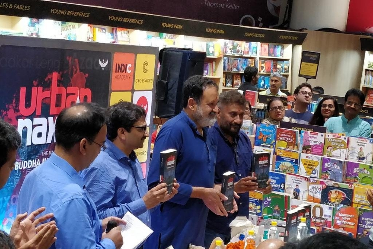 Mohandas Pai, former CFO of Infosys, fourth from left, launches the book written by filmmaker Vivek Agnihotri, to Pai's left, at Crossword book store, Mantri Mall, Malleswaram, Bengaluru, on 17 June. (IndicAcademy/Twitter)