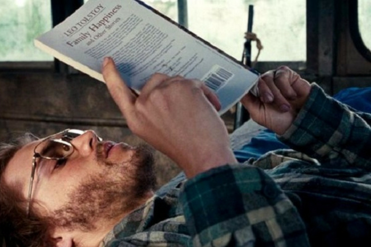 Actor Emile Hirsch's character Christopher McCandless reading Leo Tolstoy's <i>Family Happiness</i> in the Sean Penn-directed film <i>Into The Wild</i>.