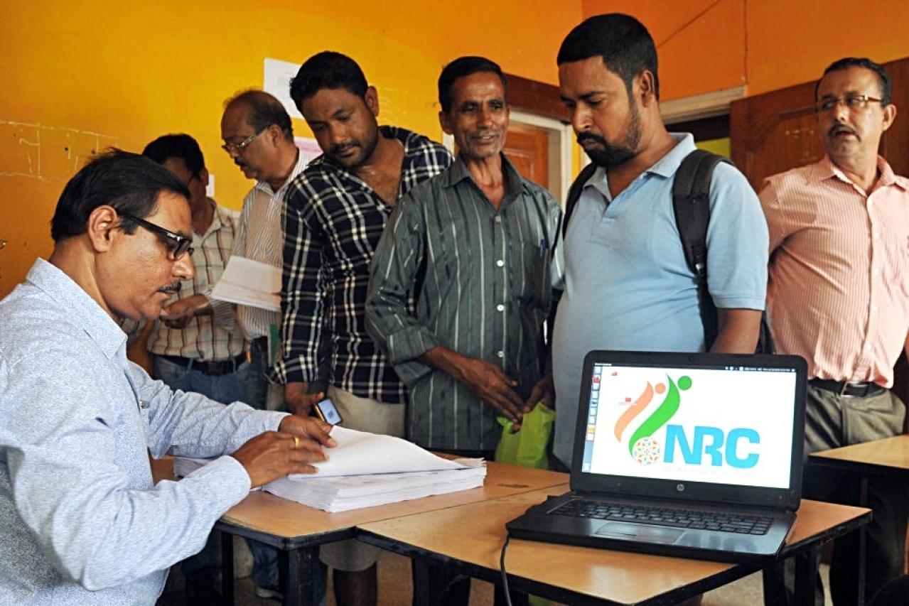 People check their names on the final draft list of Assam's NRC list in Guwahati. (Rajib Jyoti Sarma/Hindustan Times via GettyImages)