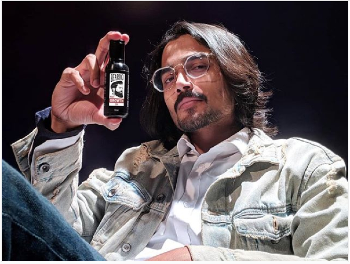 A screenshot of Bhuvan Bam posing with a bottle of Beardo on Instagram