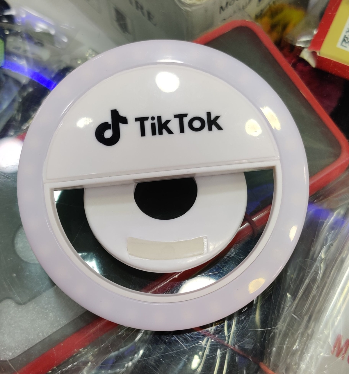 A ring light with TikTok branding on it