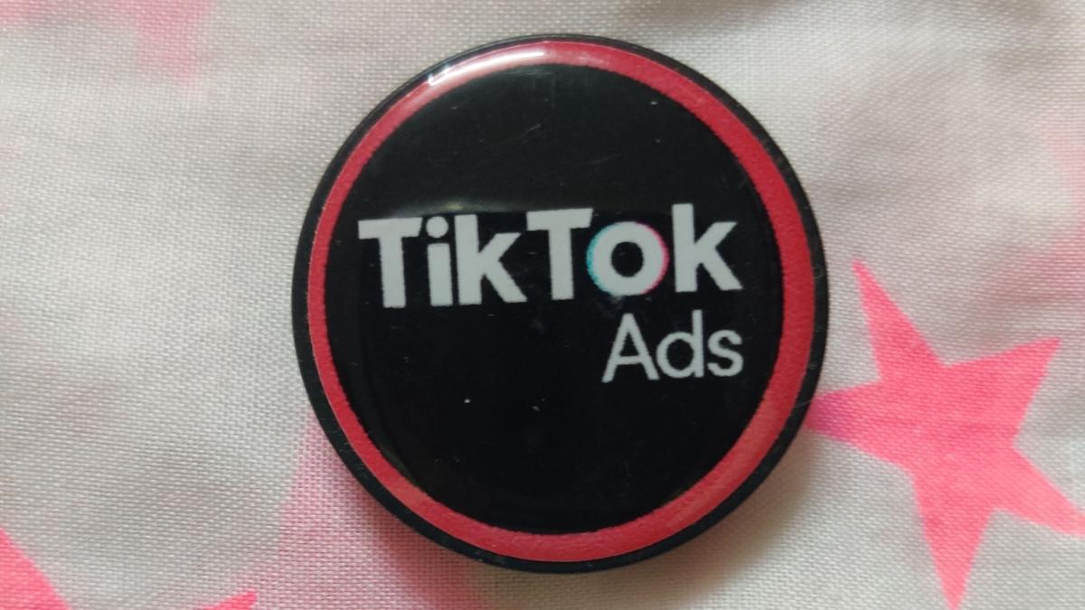 A phone pop socket with TikTok branding