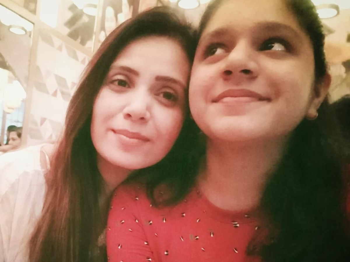 Dixit with her daughter