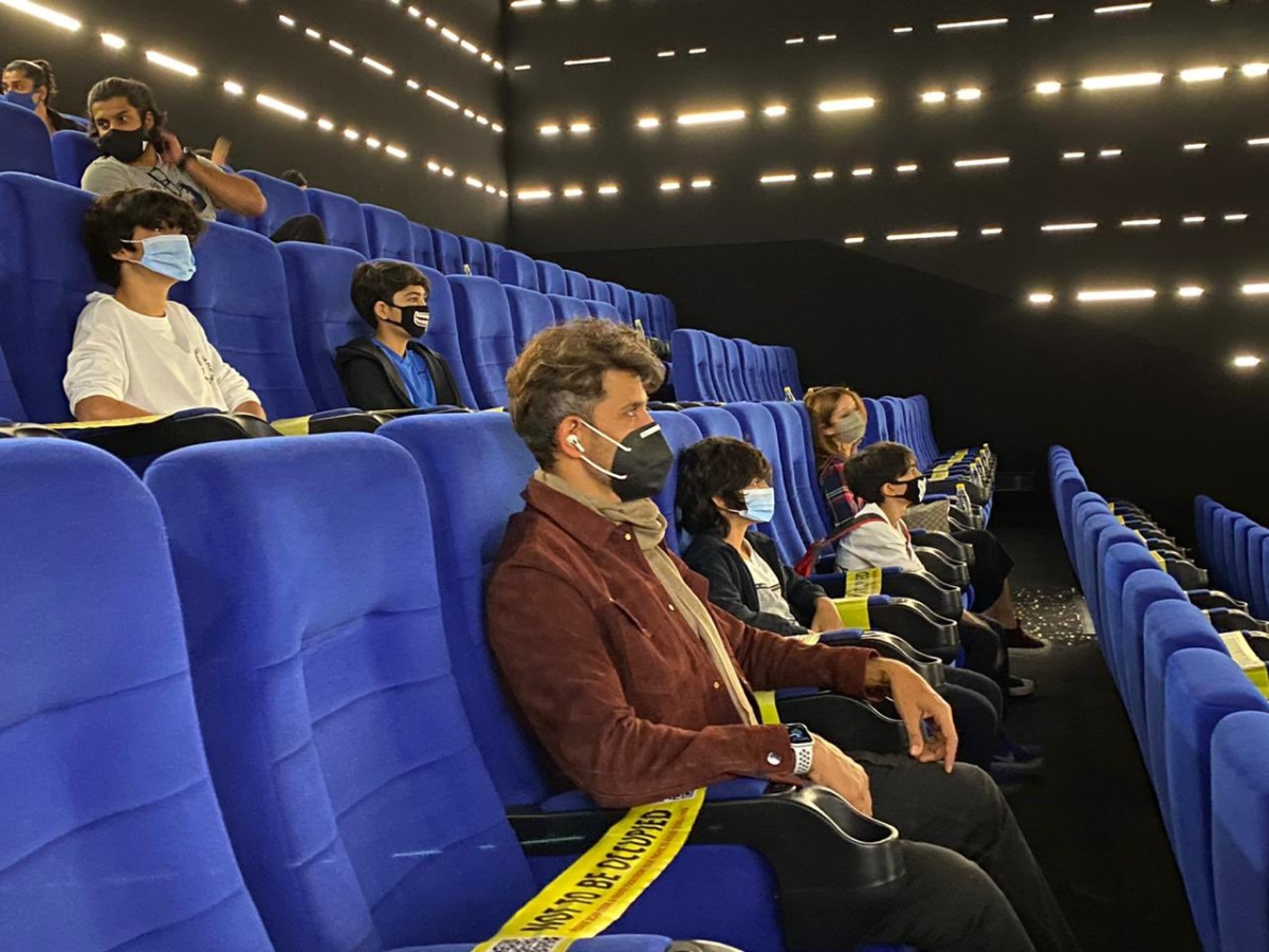 Hrithik Roshan sitting a seat apart from his son with whom he lives in the same house