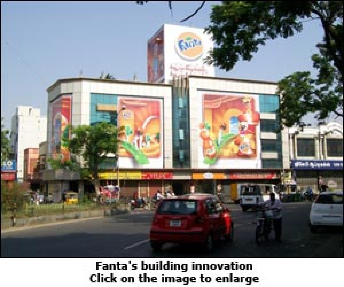 Fanta's building wrap tells an orangey story