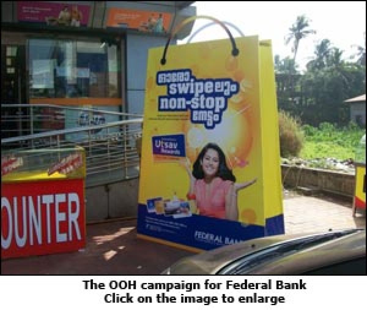 Federal Bank creates giant shopping bags to promote debit card loyalty programme