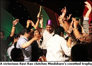 A victorious Ravi Rao clutches Mindshare's covetted trophy