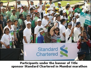 Participants under the banner of Title sponsor Standard Chartered in Mumbai marathon