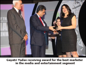 Gayatri Yadav receiving award for the best marketer in the media and entertainment segment