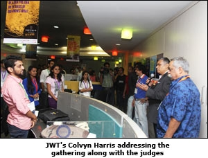 JWT's Colvyn Harris addressing the gathering along with the judges