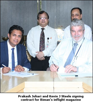 Prakash Johari and Kevin J Steele signing contract for Biman's inflight magazine