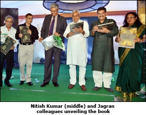 Nitish Kumar (Middle) and Jagran colleagues unveiling the book