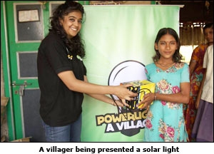 A villager being presented a solar light