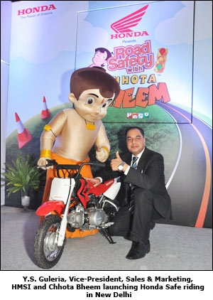 Y.S. Guleria, Vice-President, Sales & Marketing, HMSI and Chhota Bheem launching Honda Safe riding in New Delhi