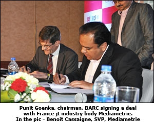 Punit Goenka, chairman, BARC signing a deal with France jt industry body Mediametrie. In the pic - Benoit Cassaigne, SVP, Mediametrie