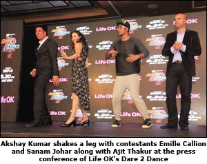 Akshay Kumar shakes a leg with contestants Emille Callion and Sanam Johar along with Ajit Thakur at the press conference of Life OK's Dare 2 Dance