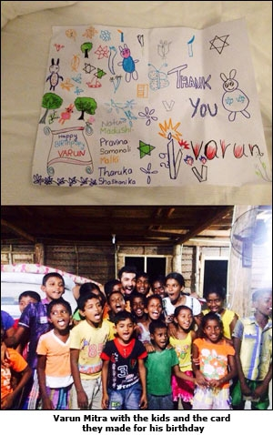 Varun Mitra with the kids and the card they made for his birthday