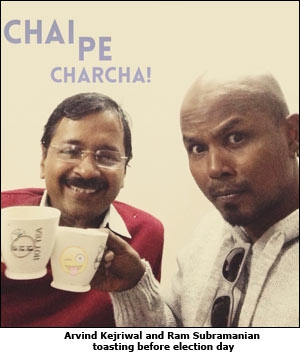 Arvind Kejriwal and Ram Subramanian toasting before election day