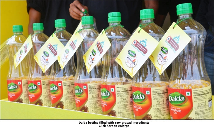Dalda bottles filled with raw prasad ingredients