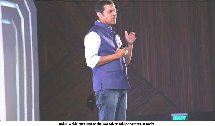 Rahul Welde speaking at the IAA Silver Jubilee Summit in Kochi