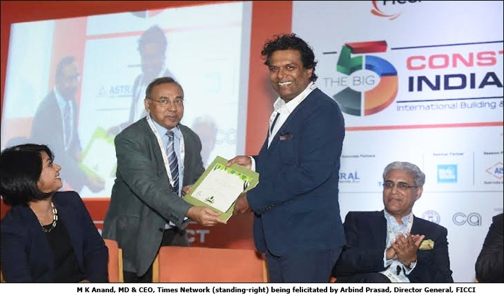 M K Anand, MD & CEO, Times Network ​(standing-right) ​being felicitated by Arbind Prasad, Director General, FICCI​