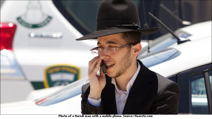 A Haredi man with a mobile phone