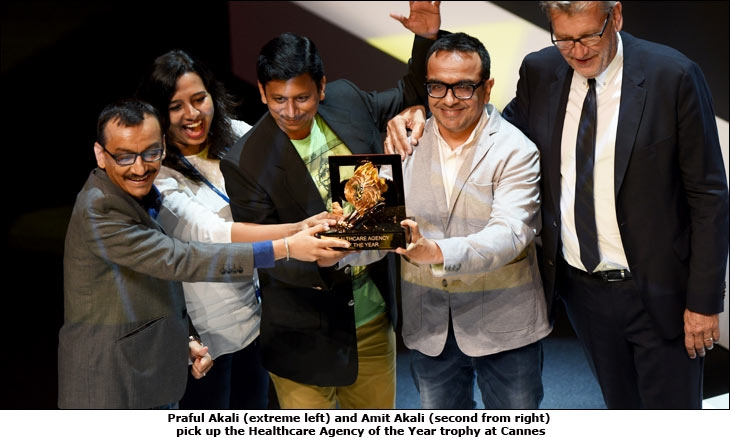 Praful Akali (extreme left) and Amit Akali (second from right) pick up the Healthcare Agency of the Year trophy at Cannes