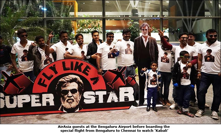 AirAsia guests at the Bengaluru Airport before boarding the special flight from Bengaluru to Chennai to watch 'Kabali'