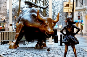 McCann NY helps client place a statue of a defiant girl in front of the iconic Wall Street bull