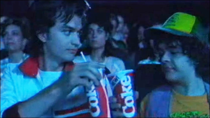 Stranger Things characters enjoying New Coke at a movie theatre