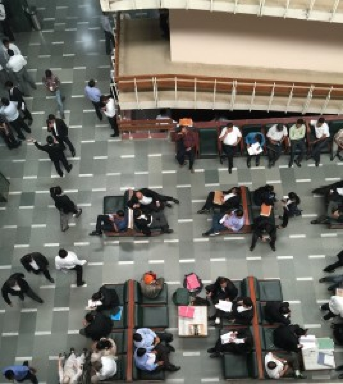 Clients and lawyers waiting in the Delhi High Court