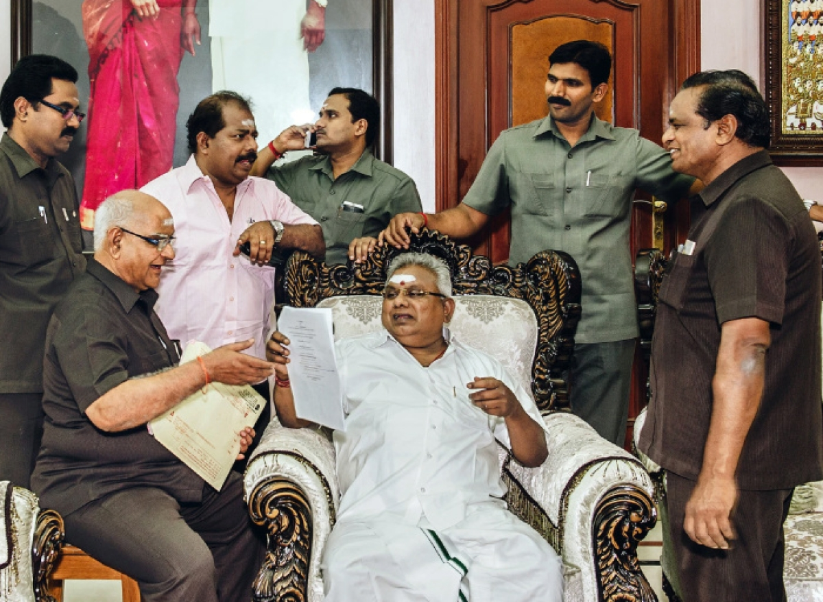 P Rajagopal (centre) was served a life imprisonment sentence for the 2001 murder of his staff